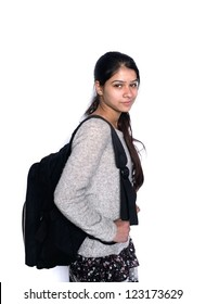 Back to school: Cute Indian student smiling with backpack, over isolated white background.