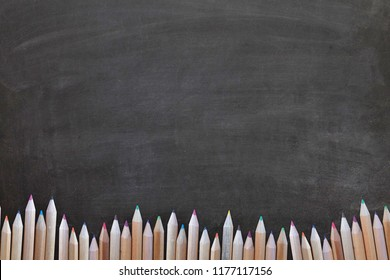 Back to school design with Colour pencil set in range on blackboard background.Education,Business office and Arts Concept.Copy space empty blank for text