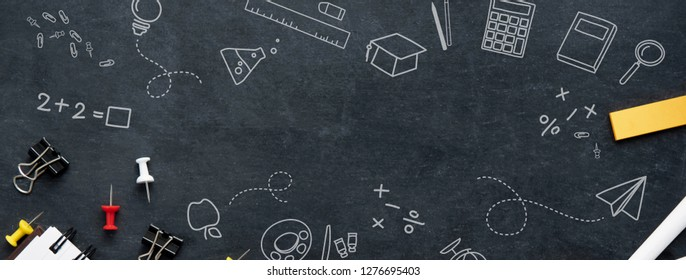 Back to school education banner background with stationery and doodle drawings on blackboard top view with copy space