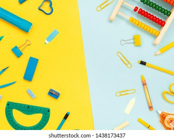 Back to school, education concept. Blue stationery tools and yellow school tools isolated on dual color yellow and blue studio background with copy space. Flat lay, view from top.