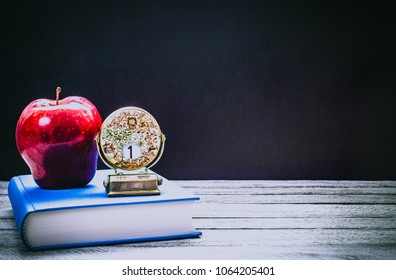 Back To School And Education Concept Book With Red Apple Antique Globe Calendar