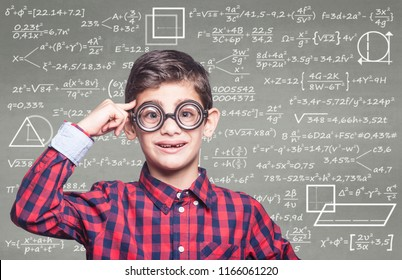 Back to school and education concept with genius school boy in classroom