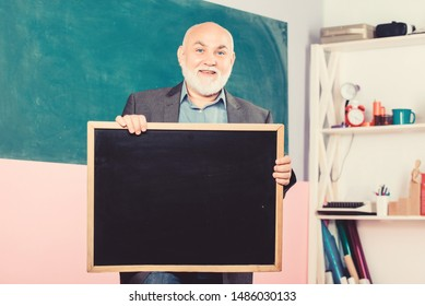 back to school. Education concept. place for copy space. Mature teacher man hold chalk board. information is here. exam and graduation results. senior man teacher with empty blackboard. Modern school.