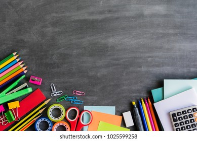Back to school education concept, school supplies stationery equipment on wooden backboard or chalkboard for student with copy space.