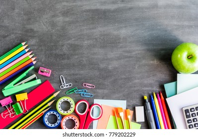 Back to school education concept, school supplies stationery equipment on wooden backboard or chalkboard for student
