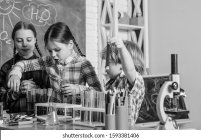 back to school. Educational. children scientists making experiments in laboratory. Pupils in the chemistry class. School chemistry laboratory. happy children. Clever teenagers doing school tasks