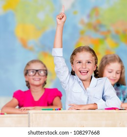 Back to school - elementary school pupil raising hand