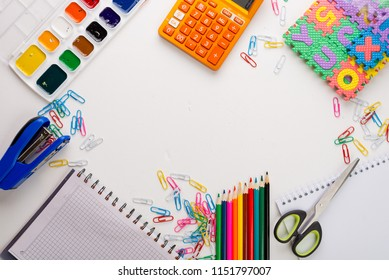 Back to school. Flat lay photo with copybook, yearbook and school supplies