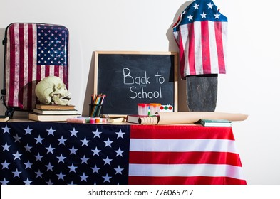 Back to school flat style background created from school supplies. USA flag, Blackgboard with lettering Back to school, biological skull