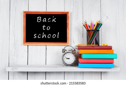 Back to school. Frame. Books and school tools on a wooden shelf.