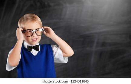 Back to school. Funny little boy in