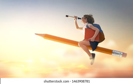 Back to school! Happy cute industrious child flying on the pencil on background of sunset sky. Concept of education and reading. The development of the imagination.