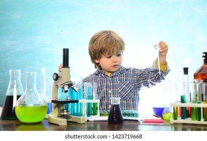Back to school and happy time Kid is learning in class on background of blackboard. What is taught in chemistry. My chemistry experiment. Home schooling. Junior year chemistry.