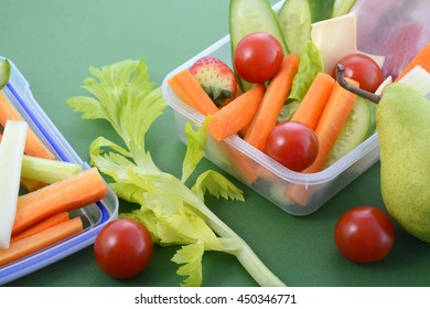 Back to school healthy school lunch box on green background, closeup.