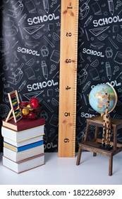 Back to school. Interior of elementary school. Chalkboard, Books, globe and stationery on classroom. Teachers Day concept. Empty classroom with blackboard. Kindergarten. Interior of children's room