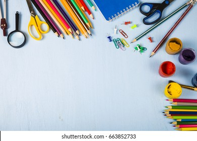 Back to school. Items for the school on a blue wooden table.