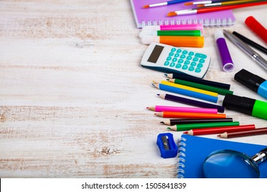 Back to school. Items for the school on a wooden table. Place for your text.