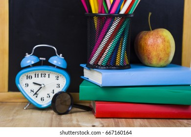 Back to school. Items for the school on a wooden table.