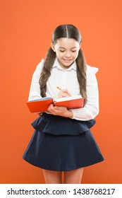 Back to school. Knowledge day. Schoolgirl enjoy study. Kid school uniform hold workbook. School lesson. Child doing homework. Your career path begins here. Write essay or notes. Inspiration for study.