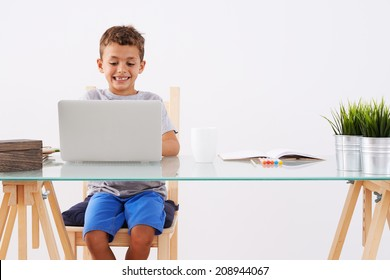 Back to School. Little boy using his laptop