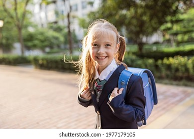 Back to school. Little girl from elementary school outdoor. Kid going learn new things 1th september
