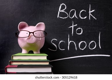 Back to school message memo reminder, chalk blackboard, piggy bank, education costs and saving concept