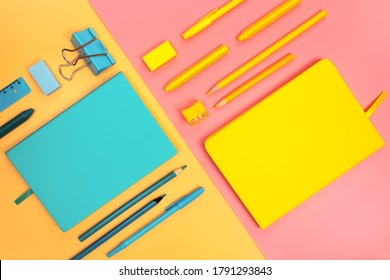 Back to school minimal concept bright pastel colors. Double paper background. Diagonal composition. Turquoise teal color stationery. Yellow stationary. Peach and millenial pink backgrounds.