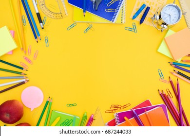 back to school or office styled  scene with multicolored school supplies on yellow , back to school conceptual background