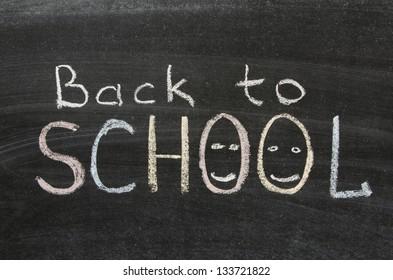 back to school phrase handwritten on blackboard