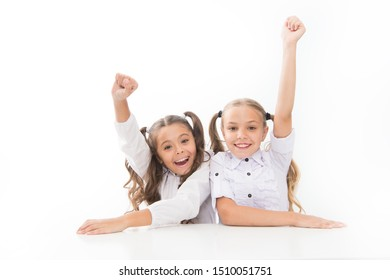 Back to school. Schoolgirls sit desk white background. Schoolgirls emotional friends. Happy childhood. Adorable schoolgirls. Education concept. Beautiful girls best friends. Formal style. First grade.