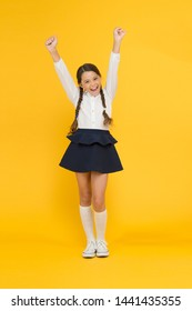 Back to school. Student little kid adores school. Emotional schoolgirl. Celebrate knowledge day. September time to study. Girl adorable pupil on yellow background. School uniform and fashion.