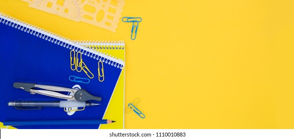 back to school styed scene with blue and yellow school supplies on yellow background banner