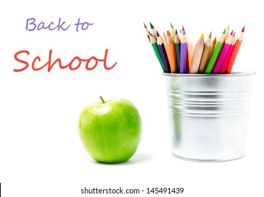 Back to school supplies with Color pencils in aluminum pencil  holders or mini bucket on white background, closeup
