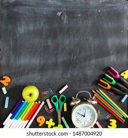 Back to school. School supplies on the background of the blackboard ready for your design. Copy space for text