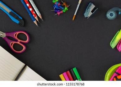 Back to school supplies on dark background. Still life. Copy space.