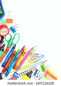 Back to school. School supplies on white background, top view. Kid creative and education concept.