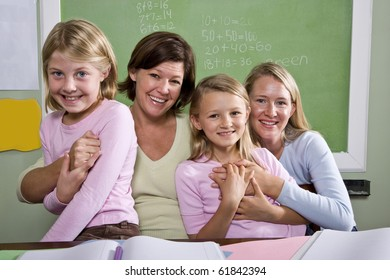 Back to school - teachers and elementary students in classroom, 8-9 years old
