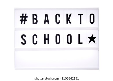 Back to school text in a light box. Box isolated over white background. A sign with a message
