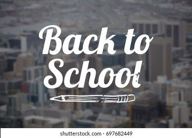 Back to school text over white background against towers and building in city