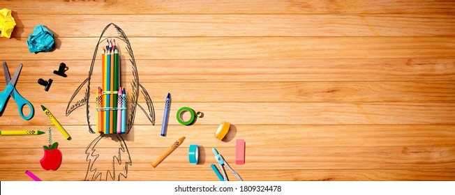 Back to school theme with a rocket with school supplies - Shutterstock ID 1809324478