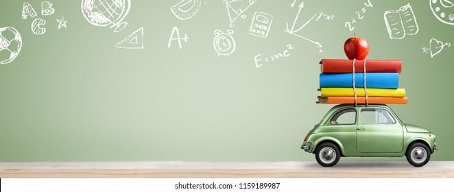 Back to school transportation. Car delivering books and apple against green blackboard.