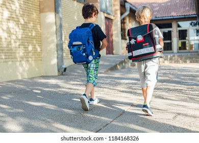 Back to school: Two happy boys going to school.