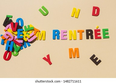 Back to school written in french language with colored letters and heap of letters
