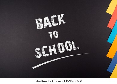 Back to School written on Blackboard, colorful papers on the side simple beautiful design, background , concept