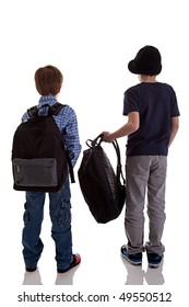 Back of schoolboy holding backpack