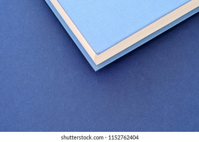 back to school,close up on pile of book covers, from above, minimal background