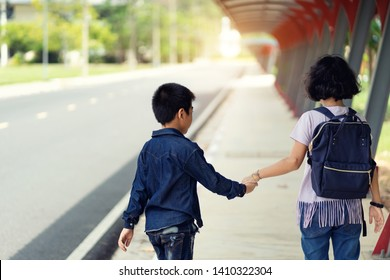 Back to school.Education.Two elementary school student with book and satchel student.Beginning of school lessons.Cute kid smiling is going to school