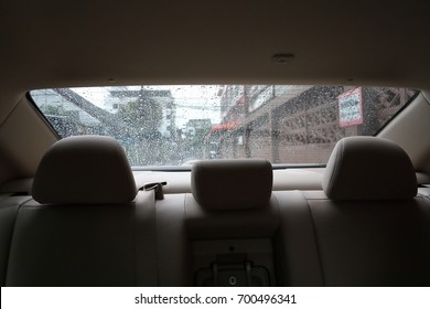 back seat inside vehicle car with rain drop on window