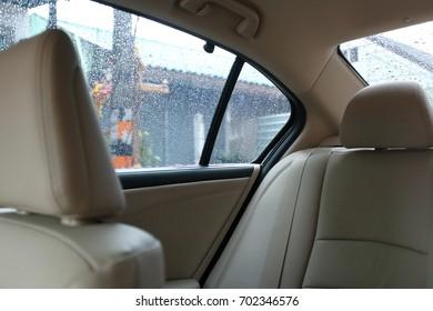 back seat inside vehicle car with rain drop on window