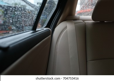 back seat inside vehicle car with rain drop on window, journey travel road trips concepts image